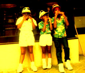 Erica Campbell, Mark Alexander and Jemeul Campbell in New Orleans blowing their Harmonicas.
