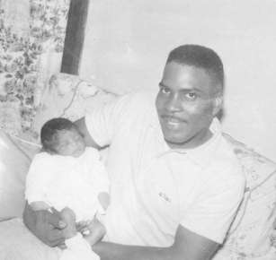 The Late James Campbell Sr. holding baby Carol Ann